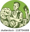 Illustration of an organic farmer green grocer harvesting green leafy vegetables set inside circle done retro woodcut style. - stock photo