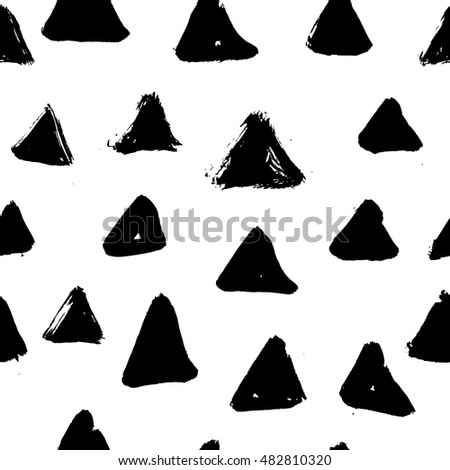 Ink hand drawn triangles. Seamless pattern.