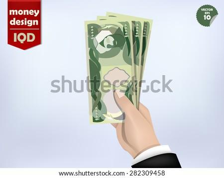 Iraqi dinar money paper on hand, iraq money cash on hand - stock vector