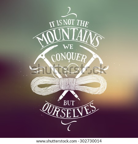 it is not the mountains we conquer but ourselves calligraphy. piolet and rope sign on blurred background. vector illustration - stock vector