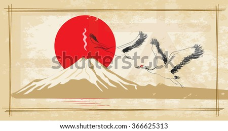 Japanese red-crowned crane flying in the sun and Mount Fuji