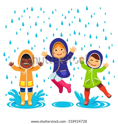 Kids In Raincoats And Rubber Boots Playing The Rain Children Jumping Splashing Through