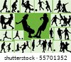Kids silhouette playing football with green background - stock