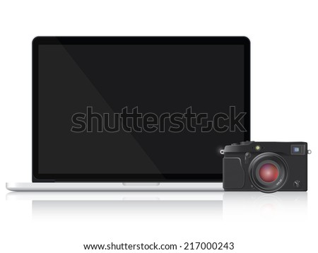 Laptop and vintage camera
