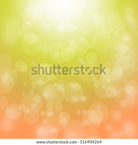 light and bokeh on orange and yellow background for christmas backdrop