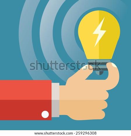 Light bulb in hand vector concept. Flat design. - stock vector