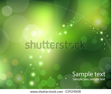 light dots and sparks on green background with bokeh effect