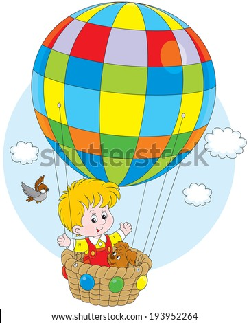 Little boy travelling with his pup on a colorful air balloon