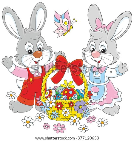 Little grey bunnies and a decorated Easter basket with colorfully painted eggs and flowers