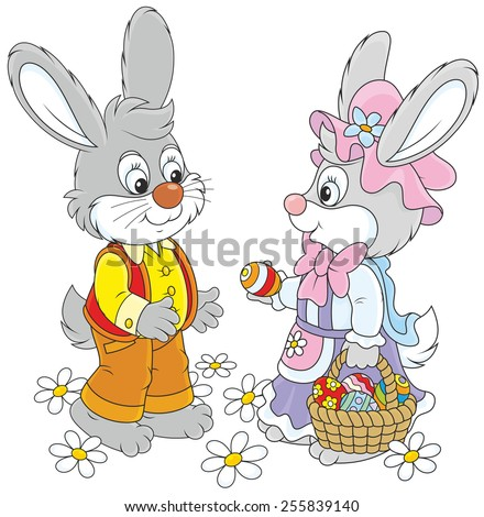 Little rabbits with a basket of Easter eggs