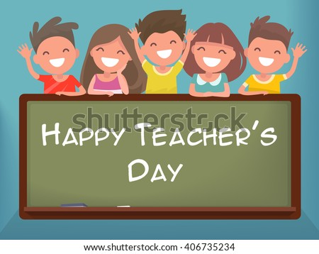 Little schoolchildren at the blackboard. Happy Teacher's Day