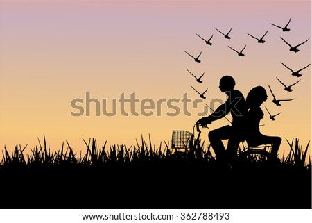 lover riding bicycle on sunset background.Silhouette valentine concept.