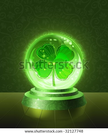 Lucky four-leaf clover seen inside the crystal scrying ball