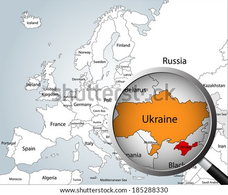 Magnifying glass over map of Europe, part of Asia and Africa, focusing Ukraine and Crimea peninsula