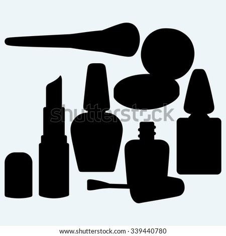 Make-up brushes in holder and cosmetics. Isolated on blue background. Vector silhouettes - stock vector
