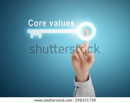 male hand pressing core values key button over blue abstract background  - stock vector
