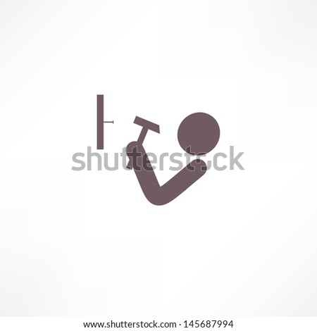 man hits the nail with a hammer icon - stock vector