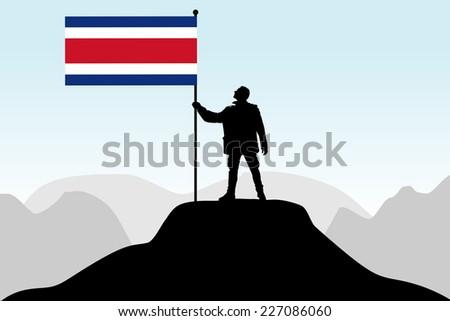 man holding a flag of Costa Rica, vector  - stock vector