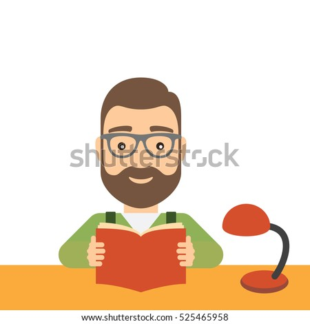 Man reads a book while sitting at the table. Concept of science, education and cultural development.