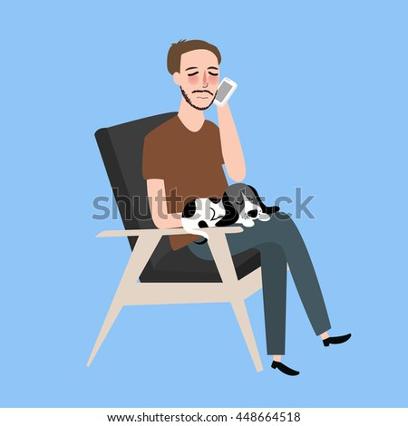 man sitting together with his cat in vintage chair