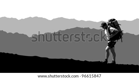 Man with a backpack going up the hill