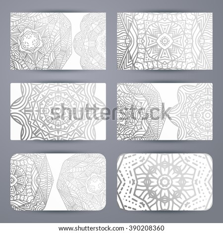 Mandala. Business card with ornament handmade in retro colors . Maroon Mandala doodle . Template mandala print . Business card  in silver and gray colors .  Sacred geometry.  - stock vector