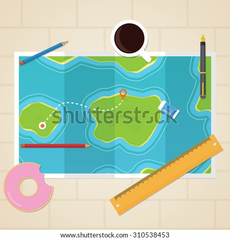 Maps on table with pointer direction and stationery around it
