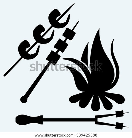 Marshmallows over a camp fire to roast and shrimp on skewer. Isolated on blue background. Vector silhouettes