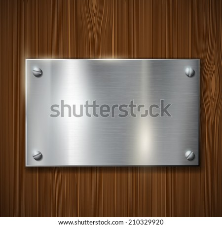 metal plate on a wooden surface