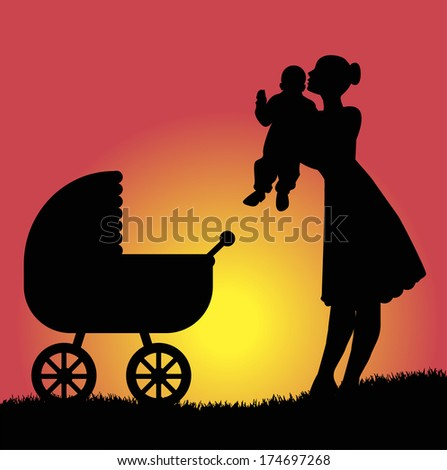 Mom with son and  stroller walk in the park