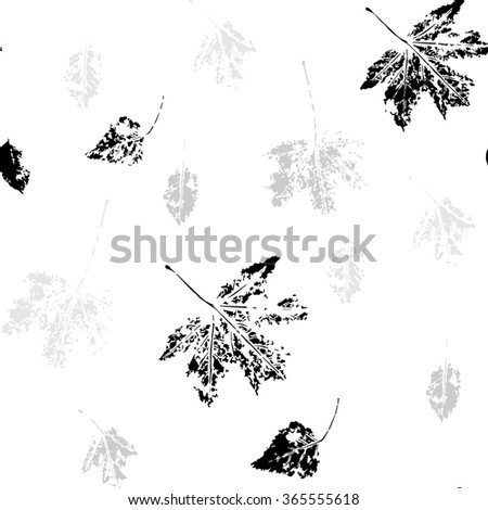 Monochrome seamless pattern with leaves of maple and poplar stylized as stamp or imprint. May be used for textile, wrapping paper or in scrapbooking