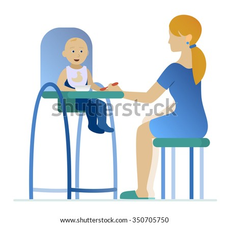 mother feeding a young child in highchair with a spoon