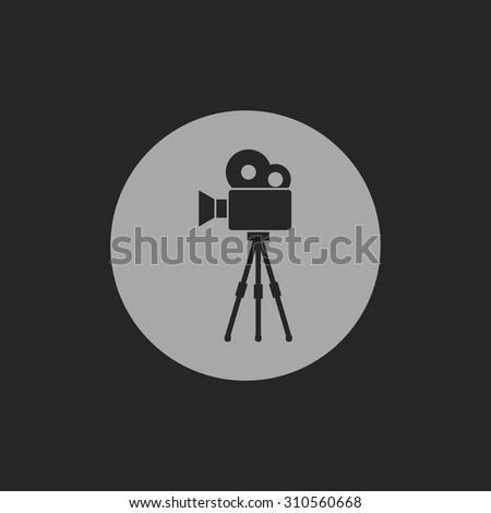Movie camera on tripod icon - stock vector