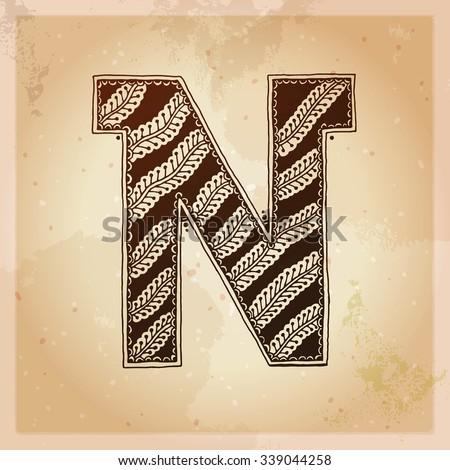 N. Decorative letter. Hand drawn alphabet, ethnic mehndi (henna) style. Vintage background, vector illustration. - stock vector