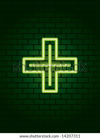 Neon medical cross on wall