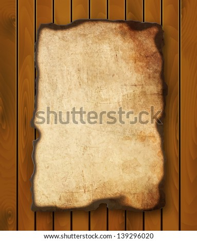 Old  paper with burnt edges isolated on a wooden background. Vector  eps10 - stock vector