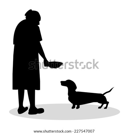 old woman to feed her dachshund