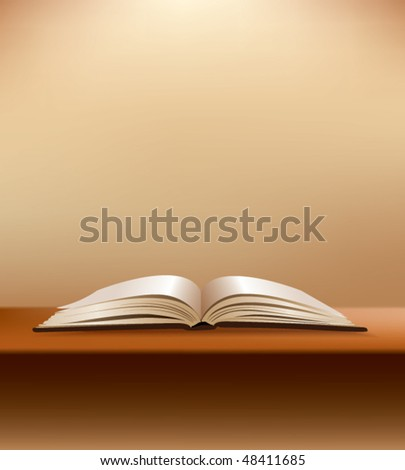open book on desk with soft brown background