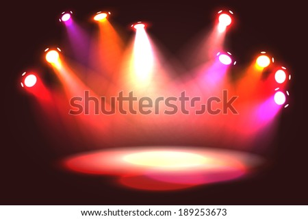 Orange, pink, violet and red spotlight projecting on empty stage