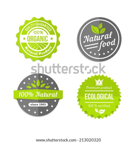 Organic  natural and eco food icons set with round labels in grey  white and green with text - Organic - Natural Food - 100 percent Natural - Ecological - with stylized leaves or crops - stock vector