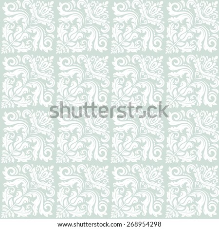 Oriental vector pattern with damask, arabesque and floral elements. Seamless abstract background. Blue and white colors