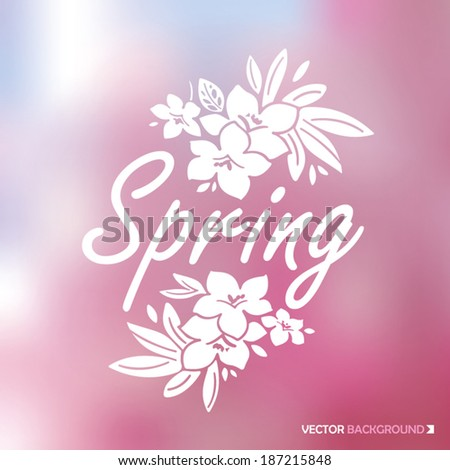 Ornamental spring emblem with colorful blurred pink background