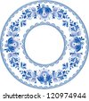 Ornate blue plate in gzhel style (traditional style of Russian ceramics, painted with blue on white). - stock