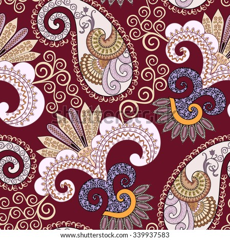 ornate seamless pattern with paisley and  decorative beige  swirls  on  bright burgundy background