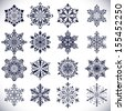 Ornate snowflake shapes isolated on white background. - stock vector