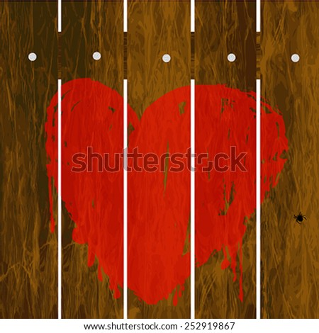 Painted red heart over wooden fence
