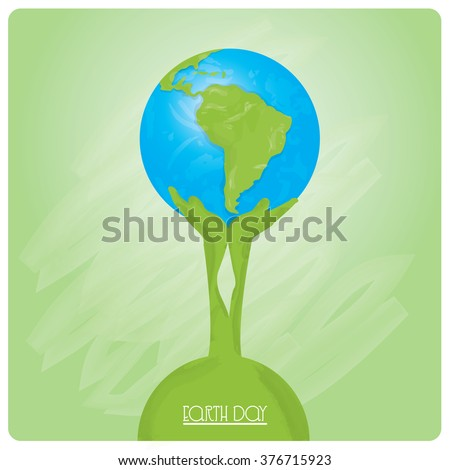 Pair of green hands holding our planet on a green background