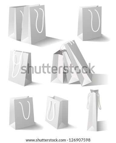 Paper bags isolated on white background. Set. Mesh tool used - stock vector
