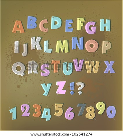 paper cut alphabet with staplers and glue tape