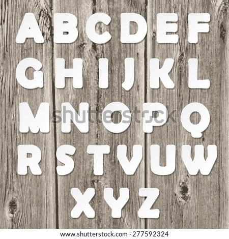 Paper cut letters on old wood texture. - stock vector